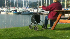 Lady with walking aid Stock Footage