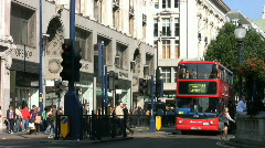Shops shoppers red buses and black cabs in Oxford Street London  England UK Stock Footage