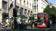 Stock Video Footage of Shops shoppers red buses and black cabs in Oxford Street London  England UK