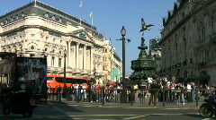 Traffic and tourists in Piccadilly Circus London England UK Stock Footage