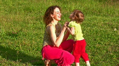 Mother with little girl on grass Stock Footage