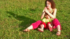 Mother with little girl on grass 2 Stock Footage