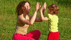 Mother with little girl play hands Stock Footage