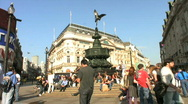 Stock Video Footage of Tourists rest below the statue of Eros in Piccadilly Circus London England UK