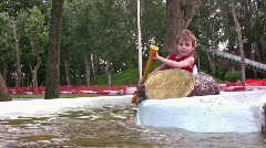 Children on attraction boat Stock Footage