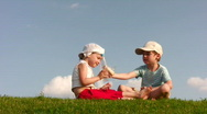 Children with food on meadow Stock Footage