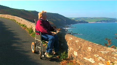 Independence with mobility aids Stock Footage