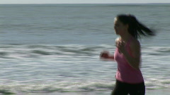 Woman on Beach Jogging Stock Footage