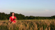 Stock Video Footage of Woman in wheat field
