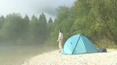 Hiker with binocular beside his tent Stock Footage