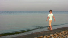 Boy on beach Stock Footage