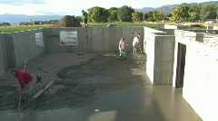 Concrete workers in basement floor M HD Stock Footage