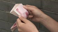 Stock Video Footage of Counting Chinese Money 1