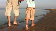 Walking father with son on beach Stock Footage