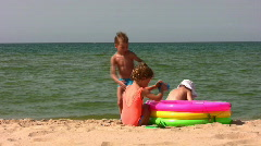 Stock Video Footage of Group children play on beach