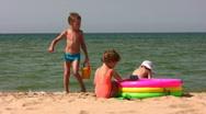 Group children play on beach Stock Footage