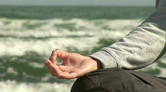 Woman Mediating on Beach Stock Footage
