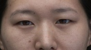 Stock Video Footage of Chinese Female Face, close-up