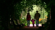 Family silhouette in plant tunnel Stock Footage