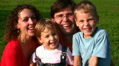 Family of four faces Stock Footage