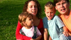 Family of four faces singing Stock Footage