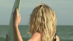 Woman with Surfboard Stock Footage