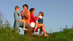 Family of four play okey-dokey Stock Footage