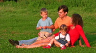 Family of four on grass Stock Footage
