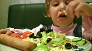 Stock Video Footage of Little girl eat salad