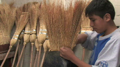 Peru: Boy learns broom making Stock Footage