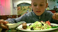 Stock Video Footage of Boy with sauce bread salad