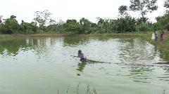 Peru: Fish pond harvesting Stock Footage