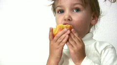 Little girl with peach Stock Footage