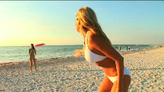 Two beautiful girls on the beach  - stock footage
