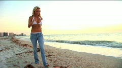 Blonde girl on the beach  Stock Footage