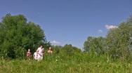 Running friends on grass Stock Footage