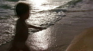 Stock Video Footage of Silhouette little girl on beach