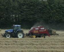 Tractor harvesting hay Stock Footage