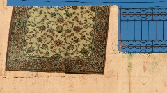 Carpet over a wall in morocco Stock Footage