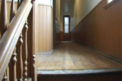 Apartment hallway wooden floorboards railing Stock Footage