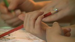 Small boy drawing with a pencil Stock Footage