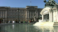 Stock Video Footage of Buckingham Palace from the fountain of the Queen Victoria Memorial in London.