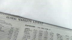 Economy newspaper micro dolly shot Stock Footage