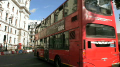 Red buses and black taxi cabs approach Big Ben clock tower in London England UK Stock Footage