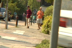 Two guys walking down dutch road Stock Footage