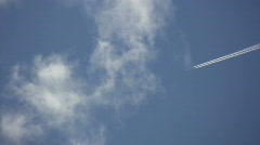 Passenger jet leaves trail. Stock Footage