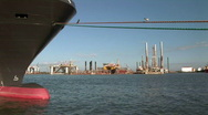 Stock Video Footage of docked ship and rigs