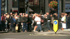 Time lapse of a crowd and traffic crossing Regent Street in London England UK - stock footage