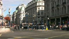 Time lapse of pedestrians buses and traffic crossing Regent Street in London. - stock footage