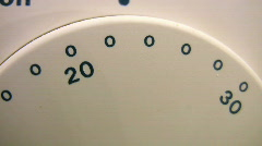 Turning central heating thermostat up and down. - stock footage